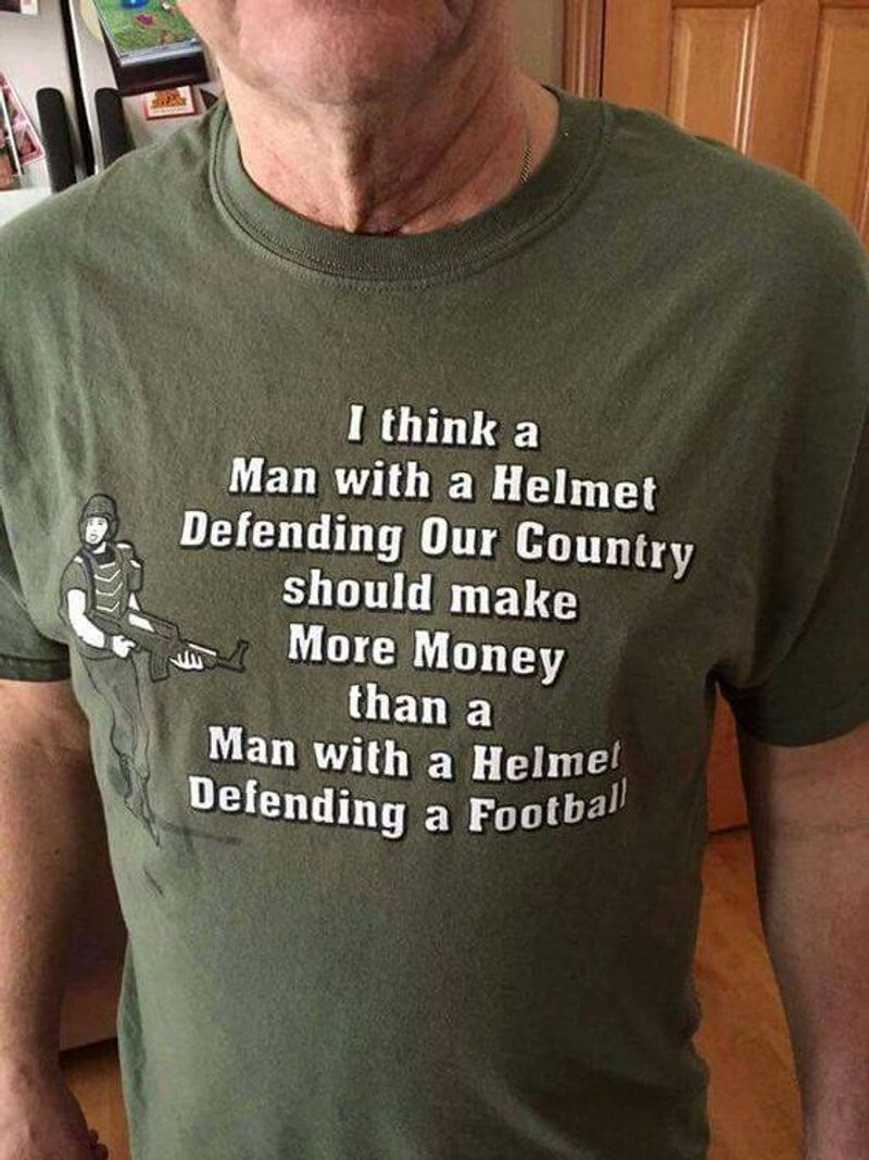 I Think A Man With A Helmet Defending Our Country Shuold Make More Money Than A Man With A Helmel Defending A Football  T Shirt Grey B1